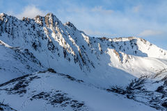 Snow mountain in Tibet. Under blue sky Stock Photography