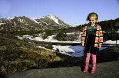 Snow mountain top with child Royalty Free Stock Photo