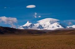 Snow mountain with umbrella cloud Stock Photo