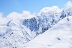 Snow Mountain Under Cloudy Sky royalty free stock image
