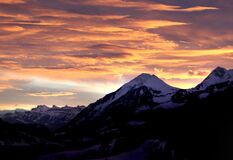 Snow Mountain Under Orange Skies royalty free stock images