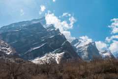 Snow mountain view with blue sky Stock Photography
