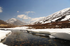 Snow Mountain View and water stream with Blue Sky at Zero Point Stock Photo