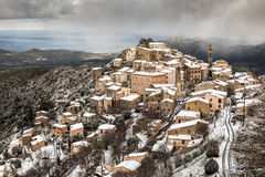 Snow on mountain village of Speloncato in Corsica Royalty Free Stock Images