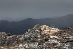 Snow on mountain village of Speloncato in Corsica Stock Photo