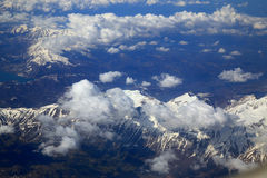 Snow mountain from window of airplane. Aerial view snow mountain from window of airplane Royalty Free Stock Images