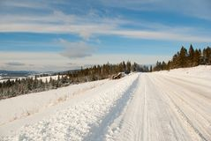 Snow mountain winter road Stock Image