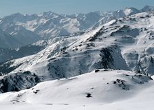 Snow Mountains. Snow mountain peaks sunny panoramic mountain landscape Royalty Free Stock Images