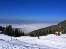 Snow and mountains. Snow and blue sky mountain panorama Stock Photography