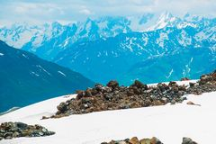 Snow on the mountains against the blue sky in the clouds.The Elbrus region.The Caucasus. Stock Photos