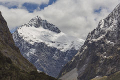 Snow mountains along Milford Sound road New Zealand Royalty Free Stock Photography