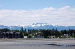 Snow Mountains And Beach Stock Photography