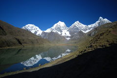 Snow mountains and azure lake in Peru stock photo