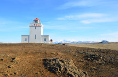 Snow on the Mountains Behind Dyrholaey Lighthouse in Iceland. Snow on the mountains behind Dyrholaey Lighthouse in Vik Iceland royalty free stock photo