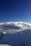 Snow mountains and blue sky. View from ski slope. Royalty Free Stock Photo