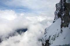 Snow mountains in cloudy weather Stock Images