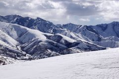 Snow and mountains at elevation. Snow covered arctic or alpine-looking mountains at elevation near Salt Lake City, Utah in the wintertime stock photos