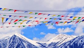 Snow mountains and flags Royalty Free Stock Photos