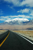 Snow Mountains and highway Royalty Free Stock Photo