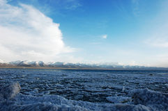 Snow mountains and ice lake in Tibet Royalty Free Stock Images