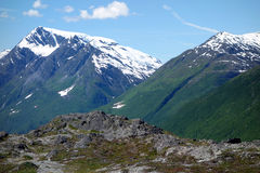 Snow on the mountains in june Stock Photography