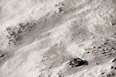 Snow on the Mountains and a Little Cabin. Snow on the Fagaras mountains and a little cabin Stock Photography