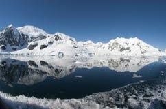 Snow mountains and ocean Stock Photo