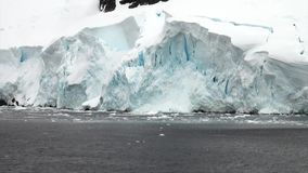 Snow mountains in ocean of Antarctica. Travel in calm cold polar north. Scenic blue water. Global warming. Unique nature of desert . Wilderness area stock video