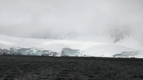 Snow mountains in ocean of Antarctica. Travel in cold polar north. Landscape of nature in ice desert . Wilderness area stock video