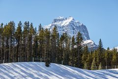 Snow mountains peaks and forest landscape under sunlight early spring as background. Nature, sky, beautiful, outdoor, scenic, travel, green, natural, view royalty free stock photography