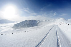 Snow mountains with road Stock Images