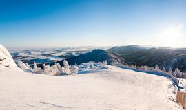 Snow, mountains and sky Stock Images