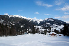 Snow, Mountains, Small Hauses. Royalty Free Stock Photography