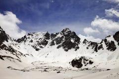 Snow mountains in spring Royalty Free Stock Photos