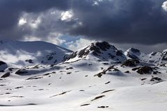 Snow mountains before storm Stock Images