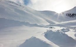 Snow mountains and sun beams Stock Photography