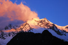 Snow mountains in sunglow Royalty Free Stock Photography