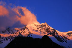Snow mountains in sunglow Stock Photography