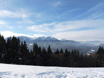 Snow and mountains. Sunny day on the mountain in Romania Stock Photo