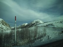 Snow on Mountains on the way to Andorra. stock photo
