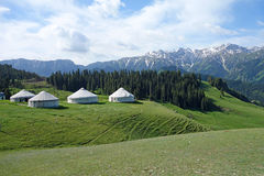 Snow mountains with yurts Stock Photo