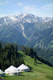 Snow mountains with yurts Stock Images