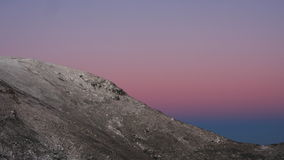 Snow moutain in the dawn. Snow moutain peak in dawn with pink to blue skys Stock Photography