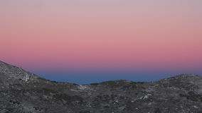 Snow moutain in the dawn. Snow moutain peak in dawn with pink to blue skys Stock Image