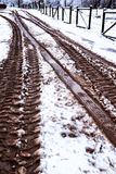 Snow and mud. Footprints between mud and snow Stock Images
