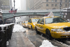 Snow in New York. Taxi line in New York during snow storm