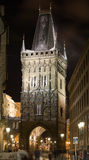 Snow in night Prague. The first snow on Powder gate in Prague at night lighting Royalty Free Stock Images