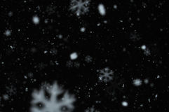 Snow on night sky Stock Photo