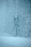 Snow obscures speed limit signs Stock Image