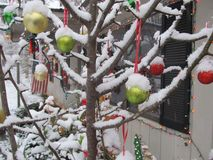 Snow on outdoor decorations Stock Photography